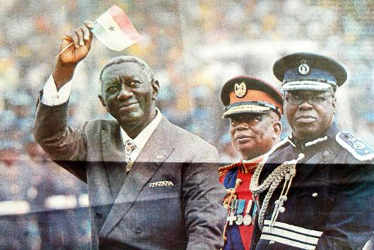 President Kufuor, wearing a suit during the Golden Jubilee Parade (front page Daily Graphic, March 7, 2007)