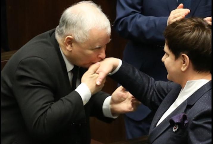 Jarosław Kaczyński kissing Beata Szydło's hand after her expose in Sejm