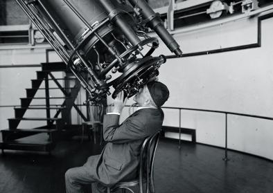 "Professor Adolphus Hall of the U.S. Naval Observatory looking through the 26"" telescope, August 18, 1924."