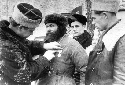 The village priest is awarded the medal