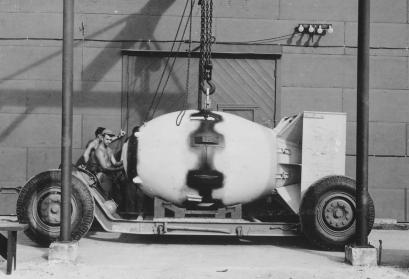 Fat Man unit being placed on trailer cradle in front of Assembly Building, August 1945.